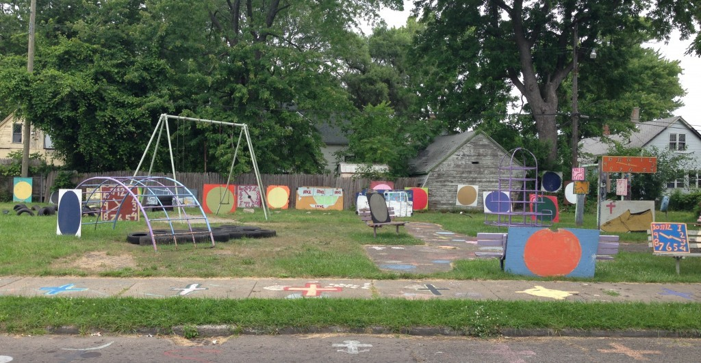 Neighborhood children have to dodge the art on the playground.